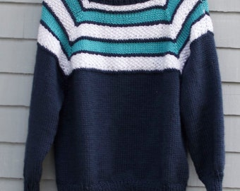 Boy/Girl size 12/14, Seamless sweater with striped yoke.