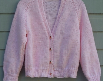 Girl, size 4, pink cardigan with strawberry buttons.
