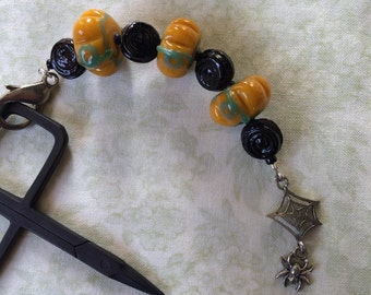 Pumpkin Harvest scissors fob with spider web charm lampwork glass beads