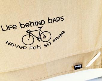 Life behind bars never felt so free bike kitchen dish towel. Silk screened cotton tea towel.
