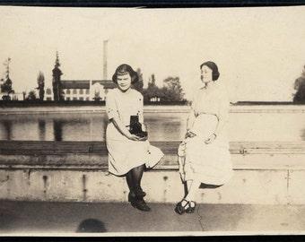 vintage photo snapshot Women sit WAll Blinded by Light Sunshine w Fold Out Kodak Camera