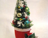 VINTAGE CHRISTMAS Snowy Bottlebrush Tree in a Santa Christmas Boot