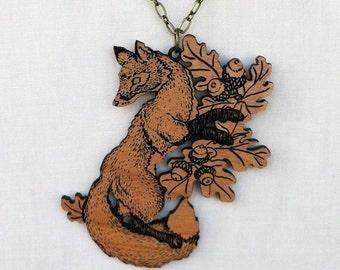 Dancing Fox and Oak engraved alder wood pendant