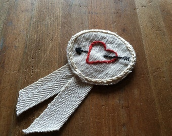 Embroidered heart award pin; cupid merit badge