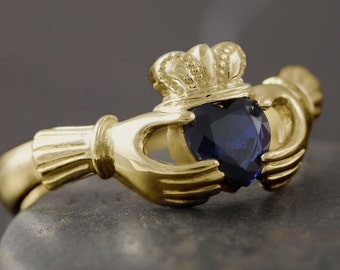 Gold claddagh ring with lab created sapphire