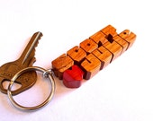 "Canarywood ""Love Keychain"" - Custom Wood Names Carved to Order"