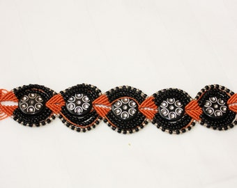 Gorgeous Handmade Micro Macrame Bracelet in Orange, Black and Silver. Magnetic Fastener