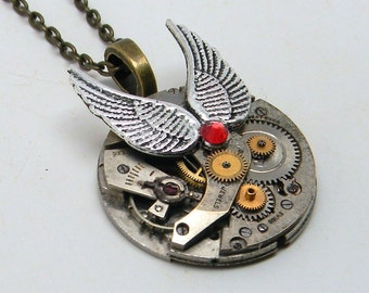 Steampunk jewelry. Steampunk watch and wings pendant necklace.