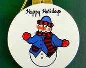 0042 Snowman blue jacket ball. Message shown is a suggestion. This can be written with a message/name of your choice. Ornaments are dated