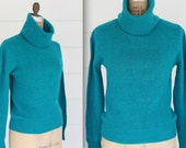 vintage cashmere sweater. 1970s teal blue turtleneck cowlneck. Med / Large. Alexander's Dept Store. Retro preppy blue green pullover