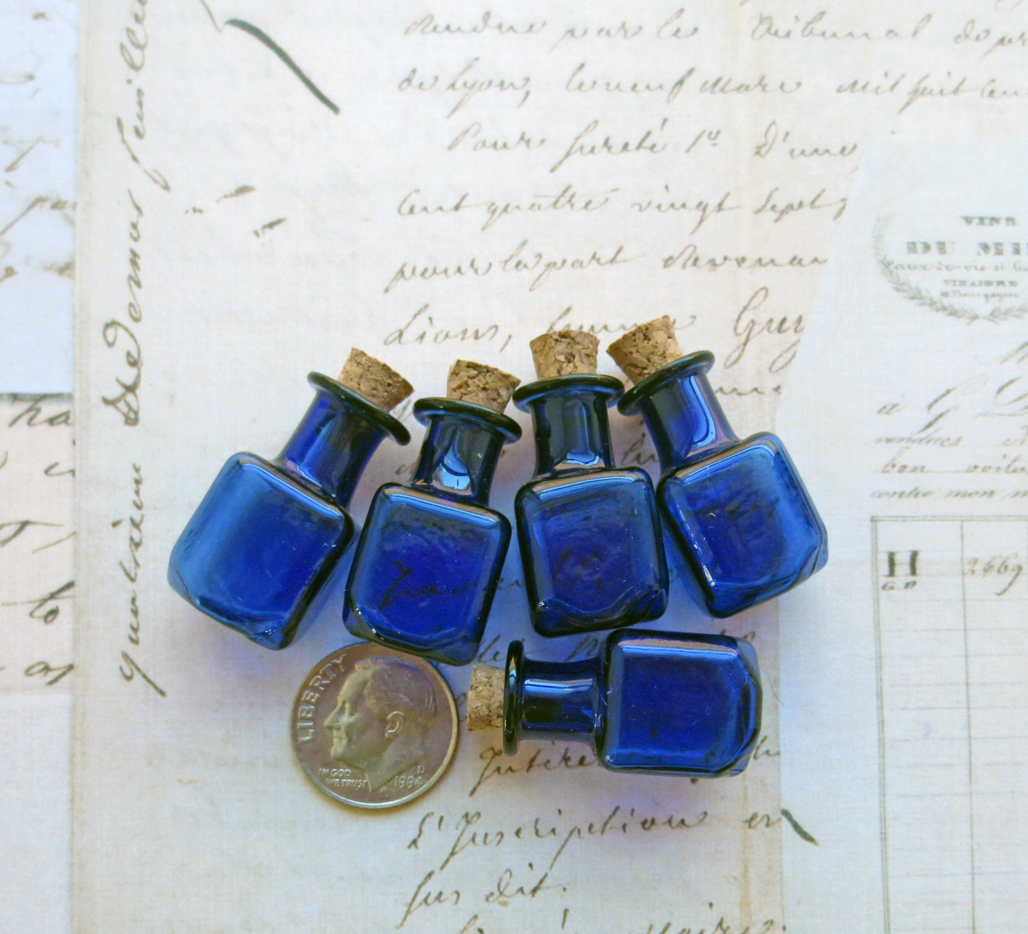 Miniature small blue colored glass bottles by for Small colored glass jars