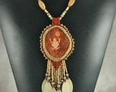Necklace, beaded, Bead embroidery,  Polymer Clay Red Rock Petroglyph