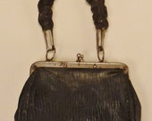 VICTORIAN MINIATURE PURSE Leather Black Metal frame braided leather handle silk lining app 6 x 3 inches 6 1/2 inch tall great condition