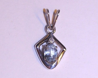 Sky Blue Topaz In Sterling Silver Pendant with White Topaz Accent