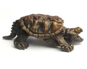 Tiny bronze snapping turtle sculpture