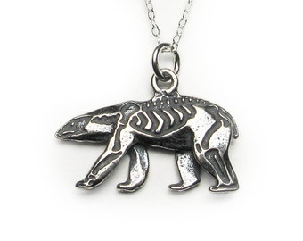 Solid sterling silver walking polar bear pendant or charm with skeleton etched on one side, antique patina.