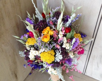 Colorful dried flower bridal bouquet. Perfect for your garden wedding.