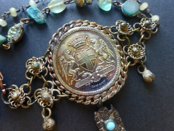 A Dream of Glory. Antique medallion assemblage bracelet with blue apatite stones.