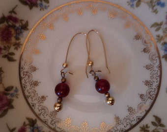Hand made classy gold and red beaded gold wired pierced dangle earrings
