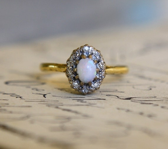 beautiful opal cabochon and diamond ring set in solid 9k yellow gold antique art deco era circa 1920 opal is very fiery and the ring is in excellent - Vintage Wedding Rings 1920