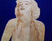 Rice straw art portrait of Hollywood legend Marilyn Manroe. BELIEVE she is made of rice straw, no color added to leaves. COLLECTIBLE art