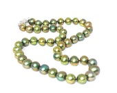 Golden peacock lustre green oval cultured fresh water pearl necklace