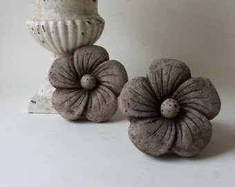 two cement flowers