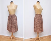 reserved //  black and peach abstract rayon skirt - s/m