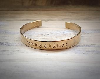 Wanderlust Brass Mesage Cuff