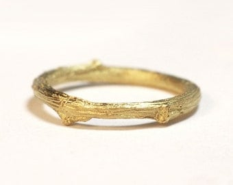 18kt gold twig ring.