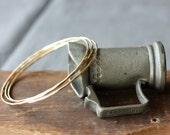 Slender gold hammered bangles- the 3 stack