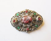 Celtic knotwork pin: Large celtic knotwork green, red and pink mock agate 1960s silver tone filigree statement costume pin brooch