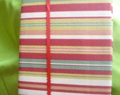 Red Green Yellow Burnt Orange are some of the colors on this Striped Fabric covered Journal