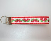 Strawberries on red webbing key chain fob wristlet