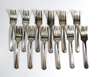 Set of 12 S.L. & G.H.R. Co. Silver Forks SG7