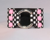 Bubble Gum Pink dommed rivets on Black and White Checkered Leather Cuff