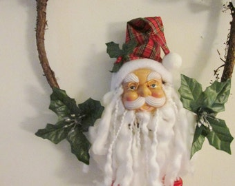 A Locust vine is home to Santa, Holly King, Father Christmas, yule, christmas, winter, solstice wreath with silk poinsettias and silver