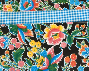 Reversible oilcloth placemats in updated floral and gingham