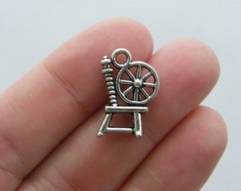 8 Spinning wheel charms antique silver tone SN15