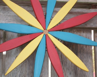 """Colorful Wooden 17"""" Starburst for Outdoor Walls (Red, Teal, Yellow) - handcrafted by Laughing Creek"""