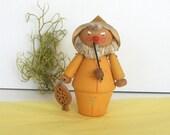 Adorable mid century Swedish fisherman figurine. Wood, metal, fiber, comical, yellow, vintage.