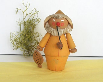 Adorable mid century Swedish fisherman figurine. Wood, metal, fiber, comical, yellow, vintage.