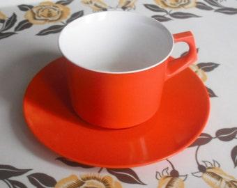 Bright orange melamine Melaware cup and saucer