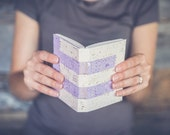 Handbound book made with handmade cream and lavender papers