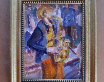 small framed original painting of saxophone player