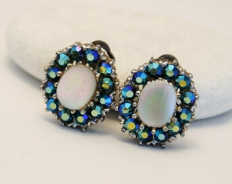 Vintage mother of pearl and rhinestone earrings.  Clip on earrings. Carnival glass. Aurora borealis