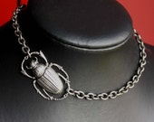 Simple Asymmetrical silver color short necklace with Egyptian scarab beetle