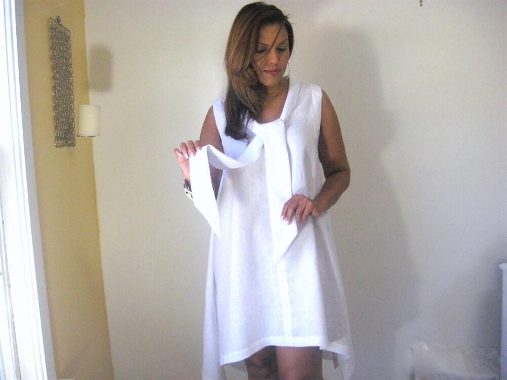 white dress white linen dress uneven hemline swing dress