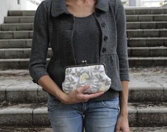 clutch bag. clutch purse. kisslock purse. metal frame purse. homecoming sparrows clutch purse