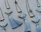 Vintage misty grey glaze 'Totem Tassel' pendant with silk thread tassel and antique brass chain.
